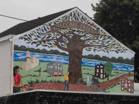 The completed mural welcomes visitors and residents alike.