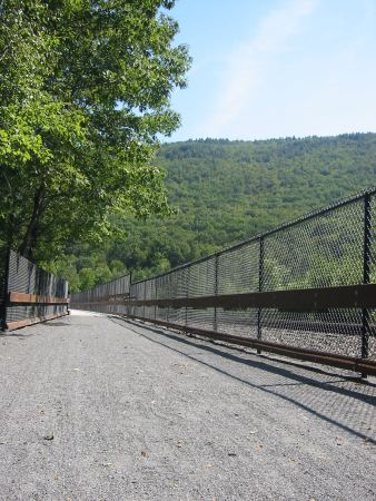 The D&L Trail crosses the Nesquehoning Trestle, with an active rail line on the right