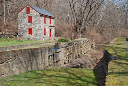 A locktender's house overlooks now-empty Lock #44 in Freemansburg (D&L)