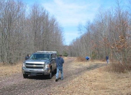 Photo 2: Sites for bollards, tree removal, or culvert installation are marked with the GPS to aid in the design process.