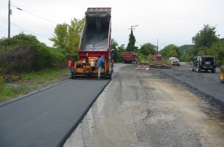 Crews put down the new trail surface