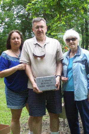 The family of Derry Bernath help dedicate a plaque and tree in his memory.