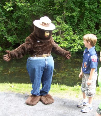 Smokey offers a hug to a young trail user.