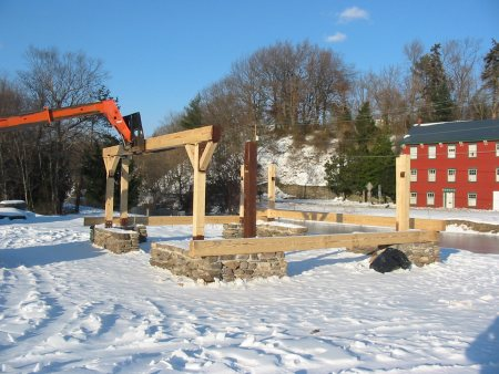 Crews place heavy timbers for Weissport's new pavillion