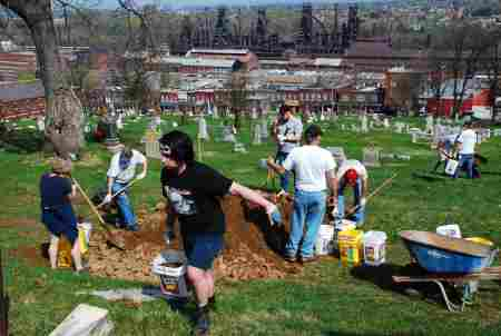 Volunteers cleanup St. Michael's cemetery. (Photo Courtesy of Dana Grubb)