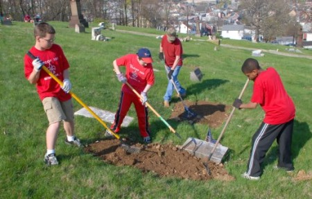 Members of Boy Scout Troop 300 help grade-off a sunken gravesite (Photo Courtesy of Dana Grubb).
