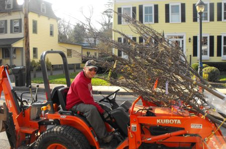 Yardley Mayor Matt Sinberg moves a bundle of trees