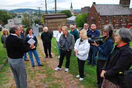 The group learns about the cemetery's history. (Courtesy of Dana Grubb)