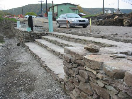 Stone work, complete with fishermen access steps, replaces the earthen canal banks