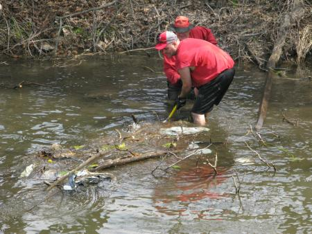 Volunteers remove debris from the canal.